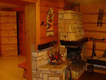 Polish style log cabin leisure room with open fire