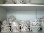 China dinner service in the kitchen cupboard