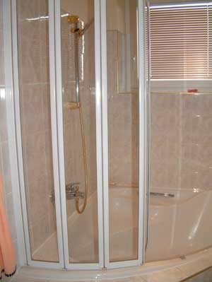 corner bath with shower over