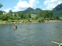 people swim and canoe fromthe banks of the Dunajec